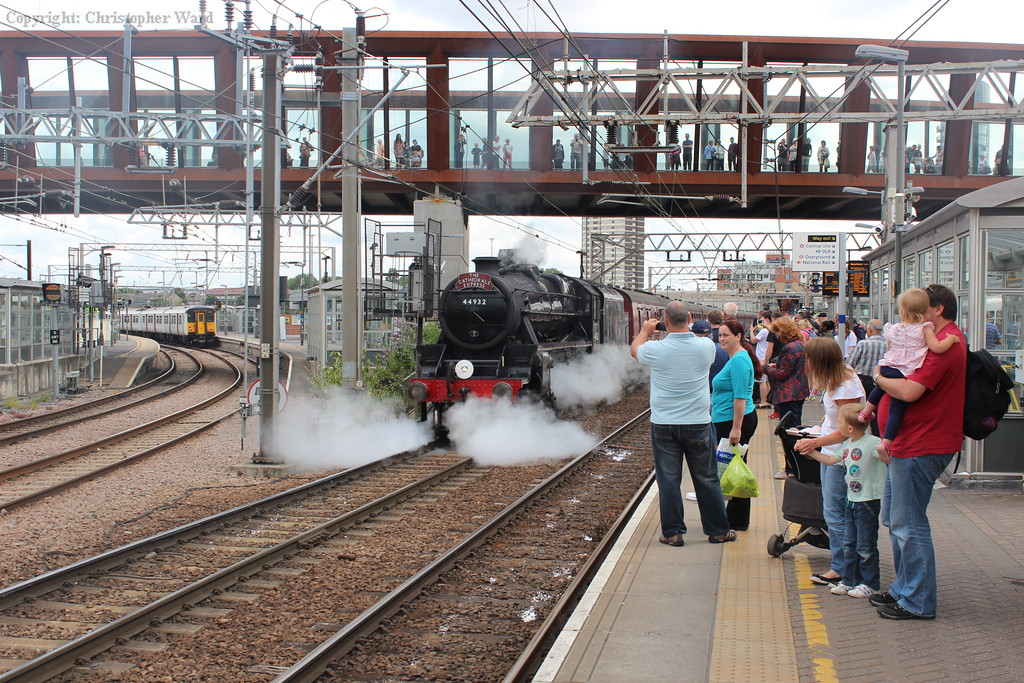 A blast of steam from the cocks as the LMS workhorse gets the train under way