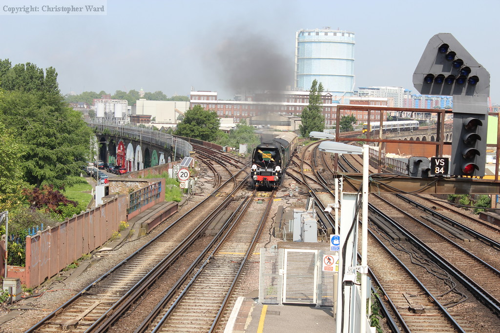The driver opens 34067 up as the train snakes over the junction and bears down on Wandsworth Road