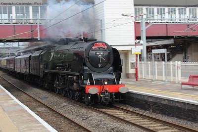 46233 blasts through Harrow & Wealdstone at speed on her way back to Tyseley