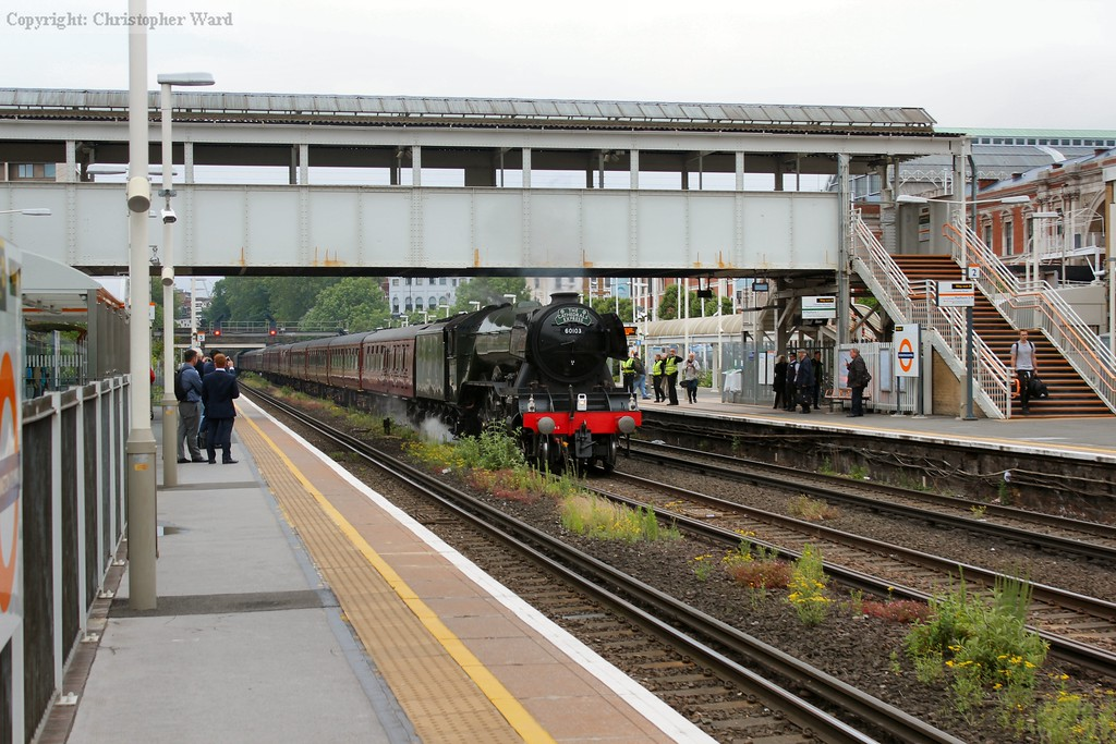 60103 saunters through Olympia on the fast line