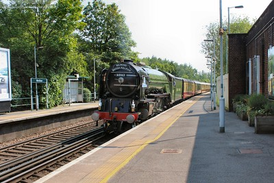 Tornado accelerates through Merstham from a signal check at Redhill and climbs toward the North Downs