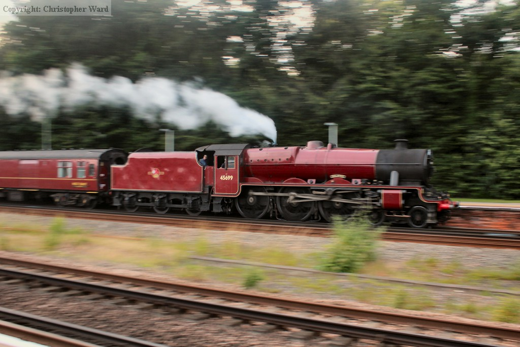 Galatea roars through Farnborough Main on the way back to Waterloo in low light