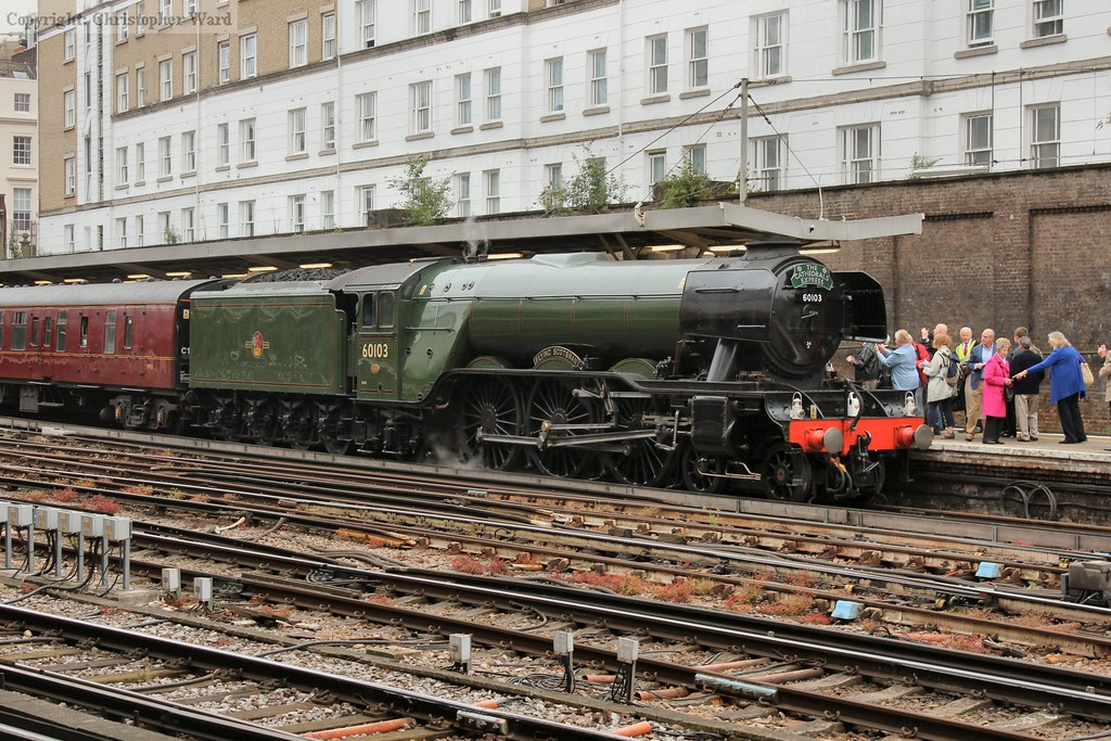 Steam starts to whisp from the safety valves of Scotsman