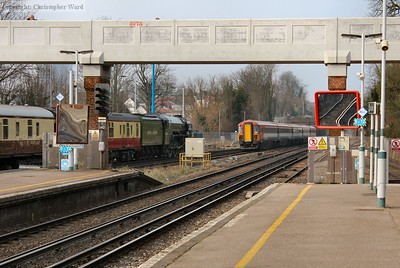 A class 442 passes Tornado during their final months of service on the Gatwick Express