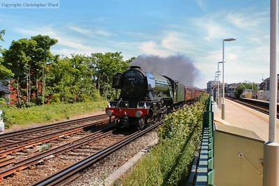 On her final approach back to Victoria, 60103 canters past Clapham High Street in the warm sunshine