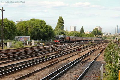 60103 crosses the junctions to head through the down fast Windsor platform at Clapham