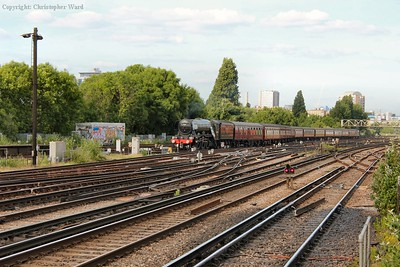 The world's most famous steam locomotive approaches Britain's busiest railway station