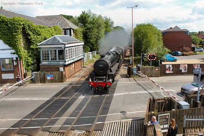 The Five passes the ex-LSWR signal box as she opens up over the level crossing