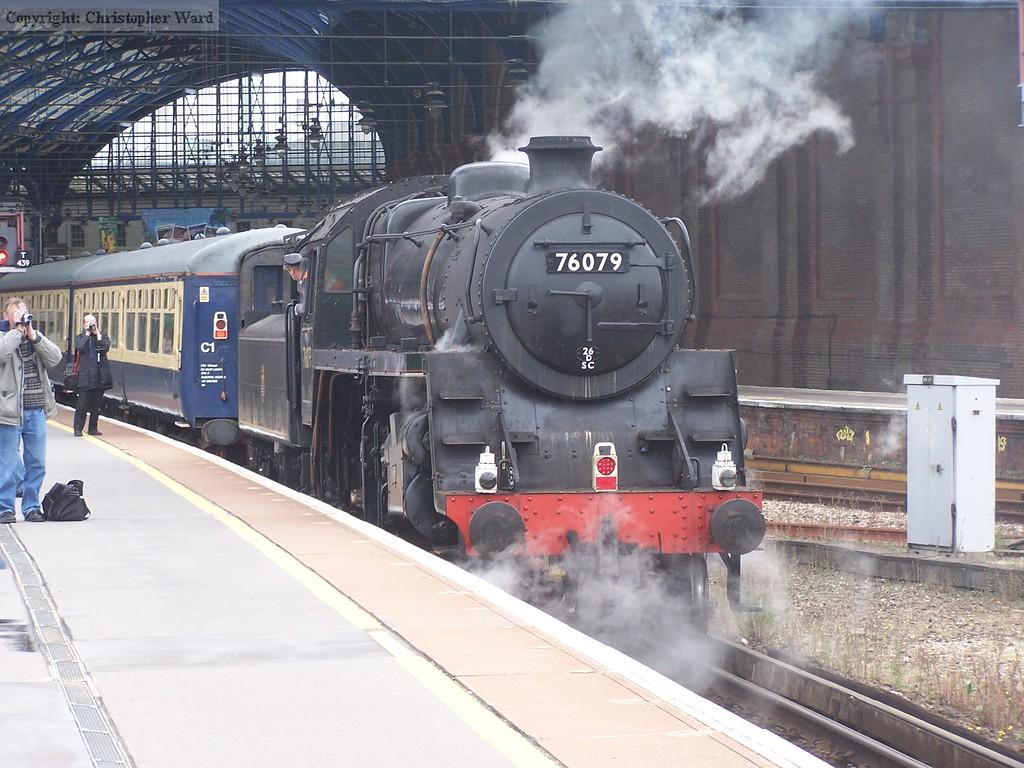 76079 backs onto the train at Brighton