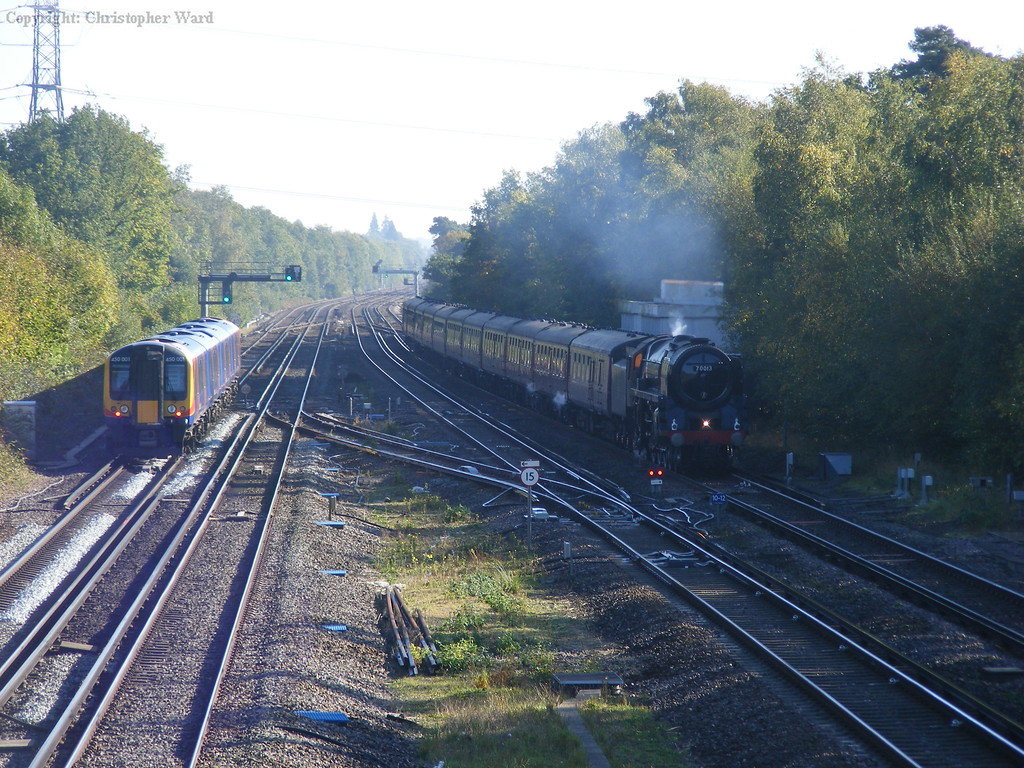 70013 slows as a modern 450 gets away from the Winchfield stop with a Waterloo train
