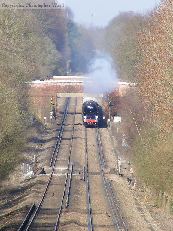 Clan Line rolls down the hill from Woking