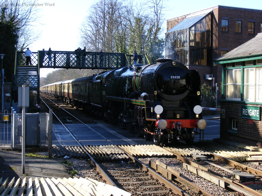 35028 powers through Reigate station with the VSOE in tow