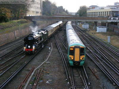 35017 is passed by a Littlehampton and Eastbourne train
