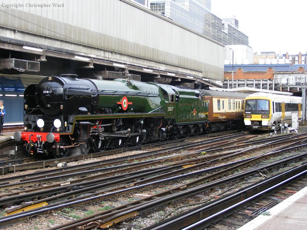 A modern Networker EMU slides in alongside the prestigious train