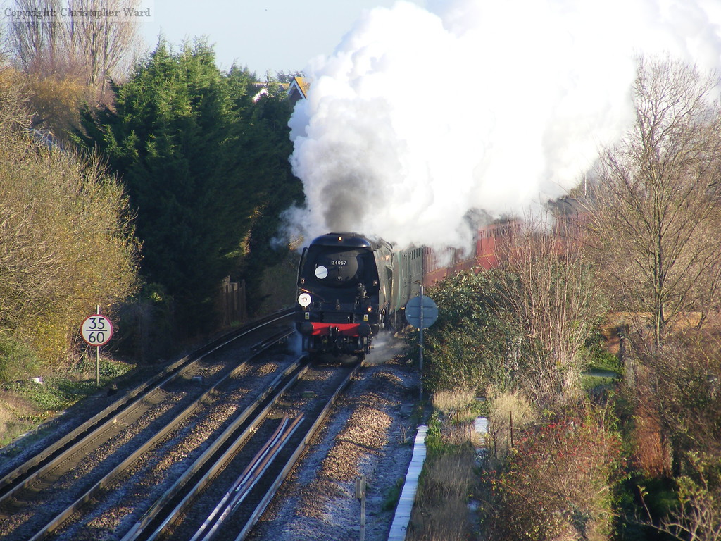 34067 rounds the bend at Bedhampton station