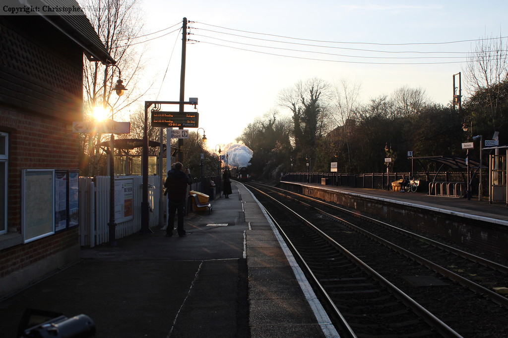 Clan Line approaches the station as the sun sets