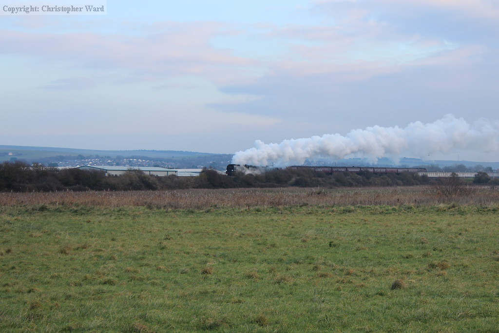 The exhaust from the Bulleid leaves a trail over the river in the frosty morning air