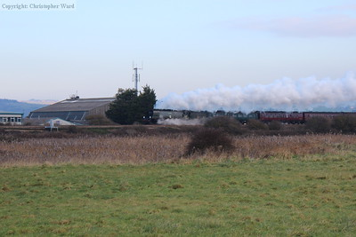 Tangmere passes some of the airport buildings
