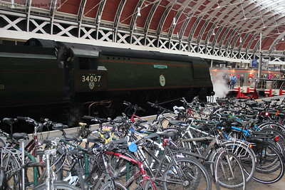 "The cycle racks at Paddington with a distinctly ""un-eco"" transport alternative behind"