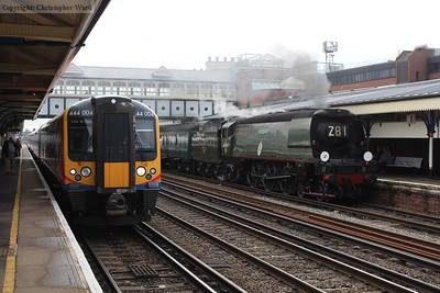 Tangmere sidles in in disgrace a full 65 minutes late as a Portsmouth to Waterloo service pulls away
