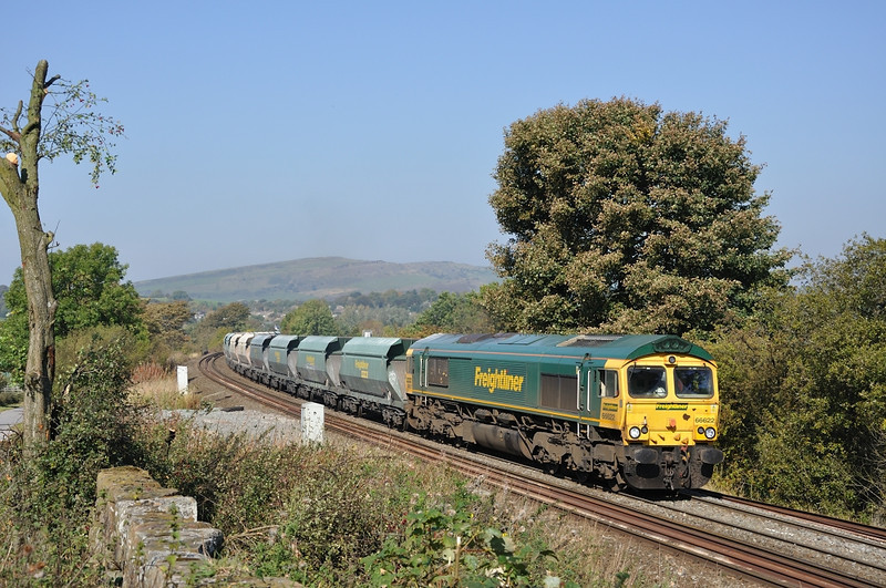 66 622 rounds the curve at Chapel-en-le-Frith with empty hoppers for Peak Forest
