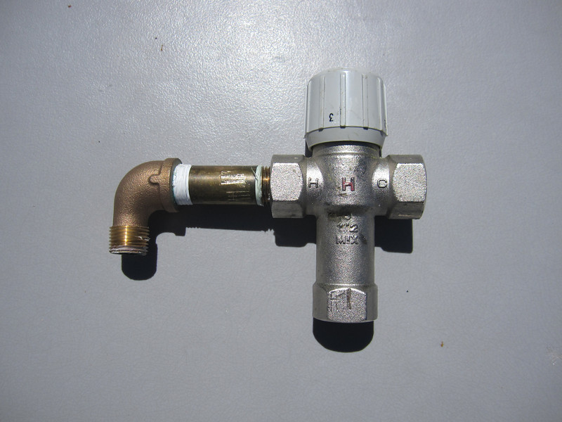 """Honeywell WAM100 with 1/2"""" female NPT.  This valve limits water temperature to avoid scalding.  It's service life is limited to about 5 years, however.  A worn out valve will cause for poor/limited hot water at the tap.  Plan on about $100 to purchase the valve."""
