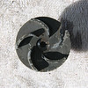 This plastic impeller deteriorated after prolonged exposure to propylene-glycol.  It lost one blade when the plastic began to crumble.  Also a center guide shaft became detached causing significant run out.  The result is a complete loss of power and pumping action.