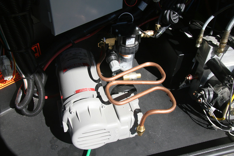 I replaced the plastic air feed line on my Thomas leveling compressor with a copper tube.  It helps cool the air and allows the compressor to move on its rubber mounts.  The best part is copper won't melt like plastic does when the air gets too hot.