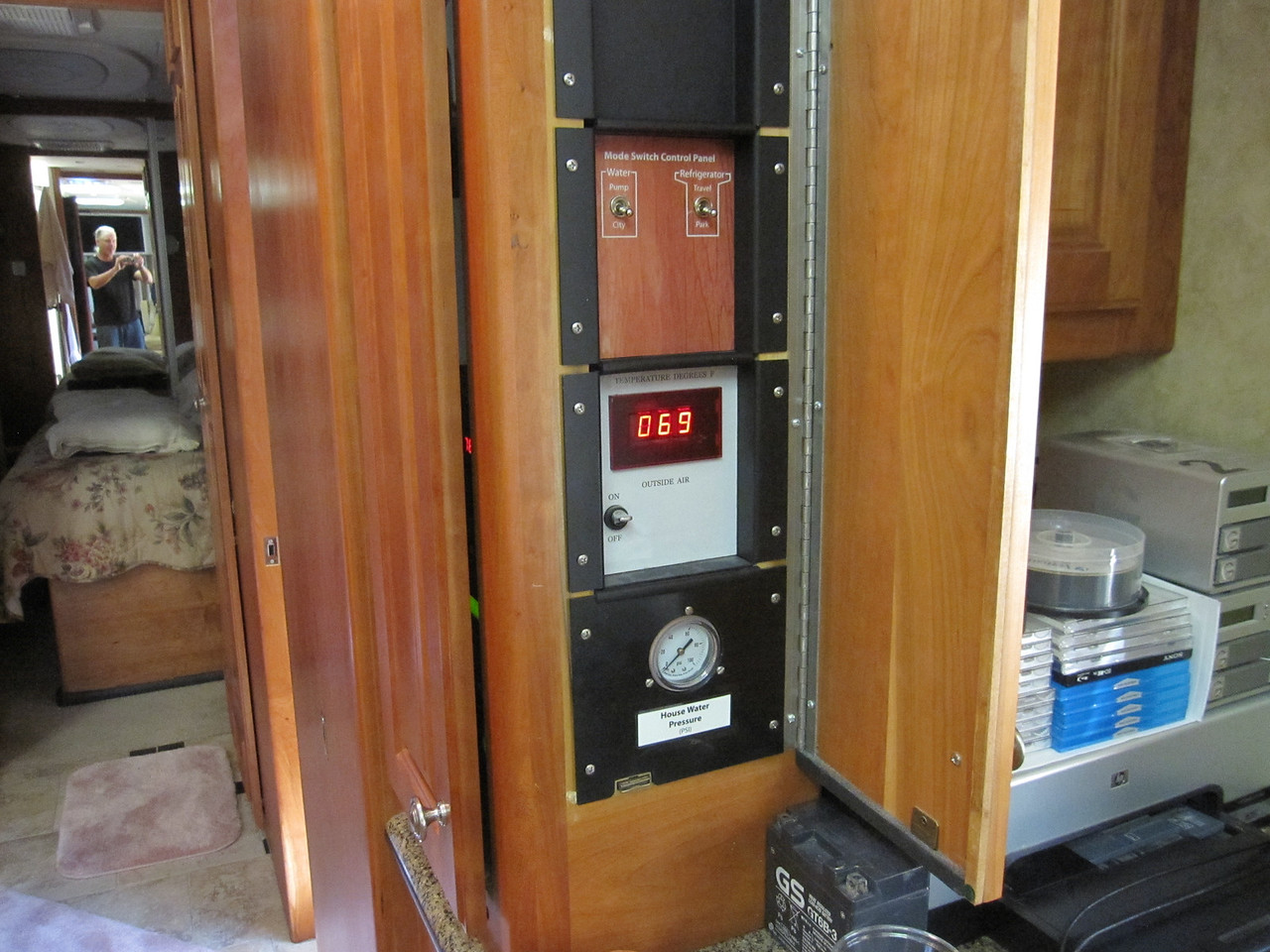 In the Allure model, this column above the pantry cabinet offers hidden space for mounting instruments, dials, gauges and controls.  I outfitted mine with removable modular panels to be appointed as required.  Some spare ones still exist.