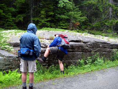 New Hampshire scaling an impenetrable cliff while BobC looks on