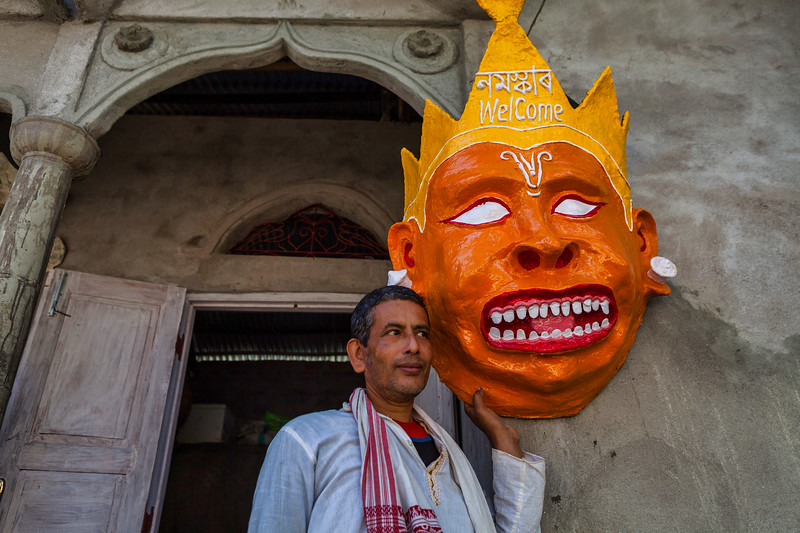Mask maker displaying his creation