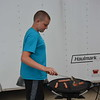Dylan Wetherell of Stewardson cooks hot dogs for Wetherell Concessions. Dawn Schabbing photo