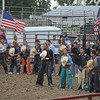Bull riders remove their hats during the national anthem. Dawn Schabbing photo.