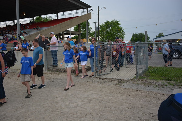 Shown are some alumni and Make-A-Wish families coming out into the arena. Dawn Schabbing photo