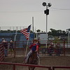 Dakota Murphy rides in with the USA flag during the national athem at the Buckin' for Wishes Rodeo at Effingham County Fairgrounds in Altamont. Dawn Schabbing photo