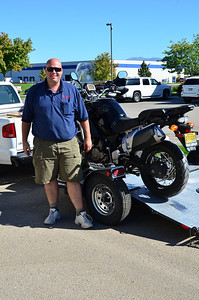 Jason Ward, chief designer for Happy Trails Products standing with the XT1200z.