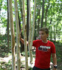 HOLLY PELCZYNSKI - BENNINGTON BANNER Leo Sobolowski, 10 years old of Shaftsbury plays the wooden windchime while on The George Aiken Wildflower Trail during The Vermont Art's Exchange Make Art, Make Noise! Camp at the Bennington Museum.