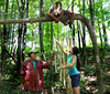 HOLLY PELCZYNSKI - BENNINGTON BANNER Matthew Perry, owner at the Vermont Arts Exchange helps construct a wooden life size wind chime with campers Sophie Kaufer 10 years old of Shaftsbury and Isabella Baker 9 years old of Bennington as she hangs from a tree tying wire.