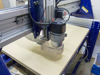 Standard ShopBot dust shoe on a Porter Cable router
