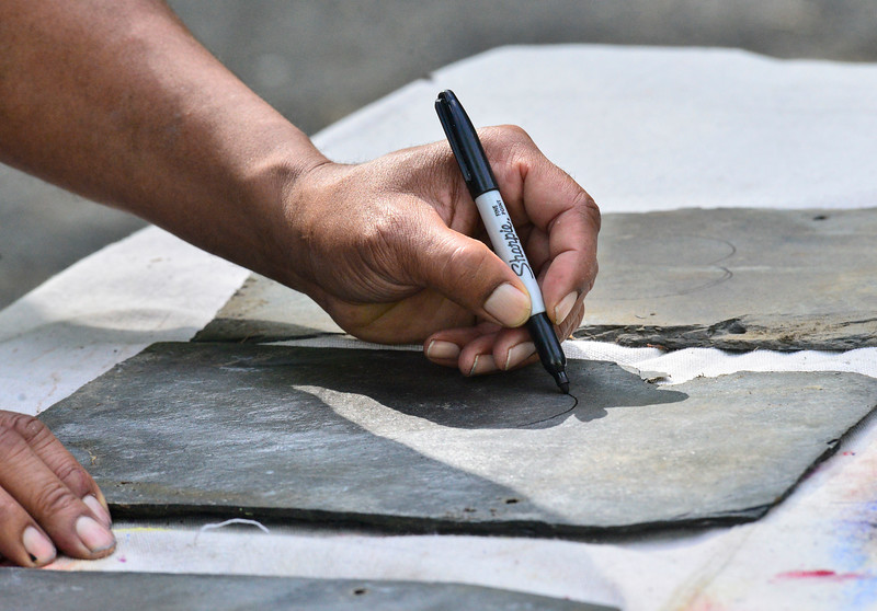 KRISTOPHER RADDER — BRATTLEBORO REFORMER<br /> Bill Forchion, of Brattleboro, Vt., paints hearts onto slate and gives them out for free to people in the community in hopes of raising their spirits during the COVID-19 pandemic.