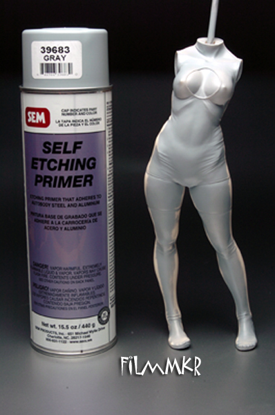 I then hit her with a coat of my favorite gray primer. I use gray because it is really easy to see any remaining seams and chingaderras that need cleanup. This is the primer I use - it is a self-etching primer that I get at my local paint jobber and is prob'ly overkill for the kind of models we build. I use self-etching primer because I build multimedia car kits that include lots of white metal and photoetched bits and other primers tend to lift off of metal parts. I've found that I never have any problems with paint lift from resin since I discovered this stuff about three years ago. It is very expensive and most of you will never need an industrial strength basecoat like this. I've recently started using Duplicolor Filler Primer.  For more information about DFP, check out the Making of Babs thread.