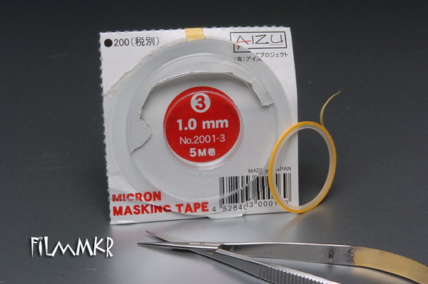I like to mask complex areas with AIZU tape. It comes in varying thicknesses, but I've found that the 1 mm width works best for masking around compound curves.