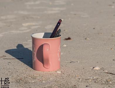 Coffee cup on beach