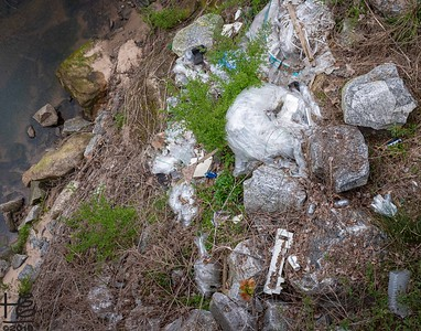 Trash by the Flint River