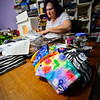 KRISTOPHER RADDER — BRATTLEBORO REFORMER<br /> Donna Tosi, of Vernon, Vt., works on making masks for the Brattleboro Retreat in her basement sewing room on March 31, 2020 while watching the news about the COVID-19 outbreak. Tosi has made roughly 135 masks so far.