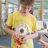 Crafter June Celona made Mexican tissue paper flowers with the kids at the Fitchburg Public Library on Tuesday afternoon. Walter Johnson, 11, works on his flower during the crafting hour. SENTINEL & ENTERPRISE/JOHN LOVE