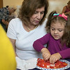 Kids got to learn about the ingredients that go into slasa before they made some themselves at the Leominster Public Library Wednesday, August 21, 2019. Cutting up a tomato for her salsa is Gianna Quinn, 4, as her grandmother Laura Casey looks on. SENTINEL & ENTERPRISE/JOHN LOVE