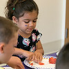 Kids got to learn about the ingredients that go into slasa before they made some themselves at the Leominster Public Library Wednesday, August 21, 2019. Cutting up a tomato for her salsa is Cici Faria, 5, from Leominster. SENTINEL & ENTERPRISE/JOHN LOVE