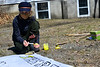 Skyler Cavanaugh, 12, paints a banner on Tuesday, April 6, 2021, to be used during a climate march on April 17.