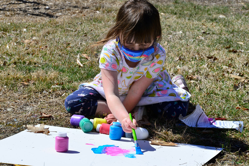 Rosemary Moore, 4, of Dummerston, paints a banner on Tuesday, April 6, 2021, to be used during a climate march on April 17.